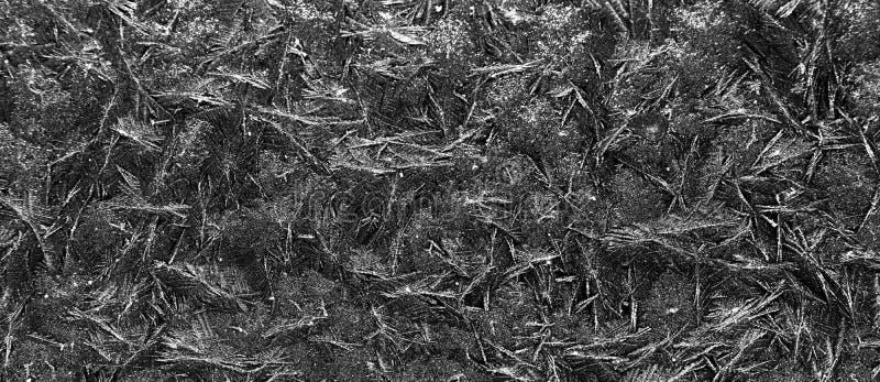 Abstrakcyjny wzór na szkle Szkło mrożone z tłem lodu Naturalne płatki śniegu Mróz Zamknij zamrożone zwycięstwo zdjęcia stock