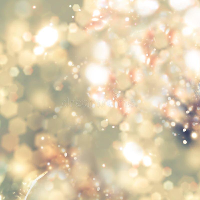 Abstrakt bakgrund av guld- ferieljus Jultomtebloss arkivbild