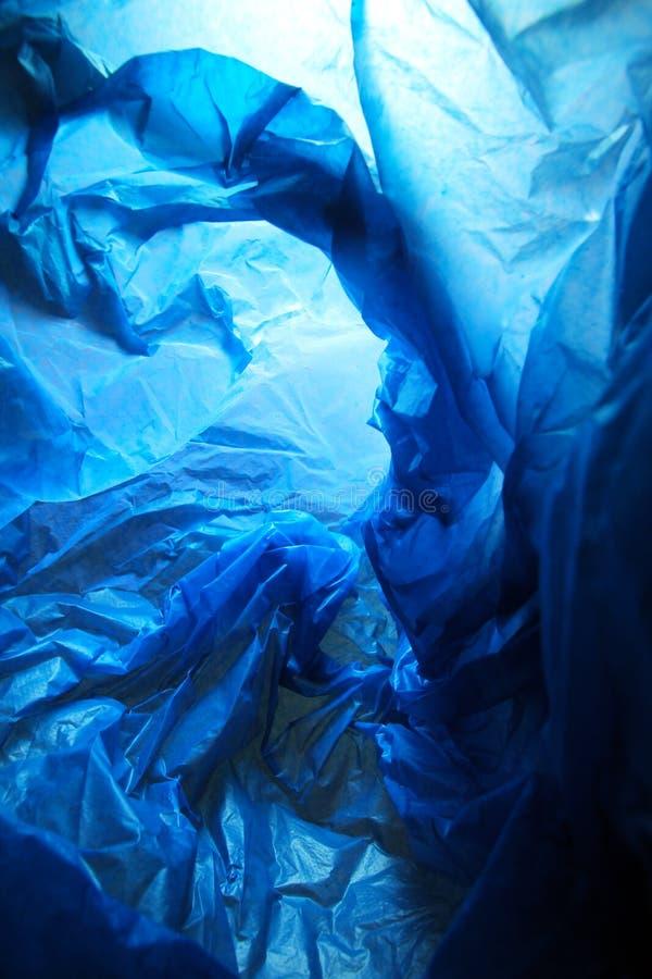 Abstrakt bakgrund av insidorna av en blå plastpåse - serie 2 royaltyfri fotografi