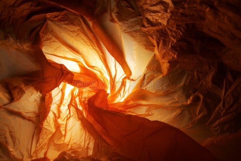 Abstrakt bakgrund av insidorna av en orange plastpåse - serie 2 arkivfoton