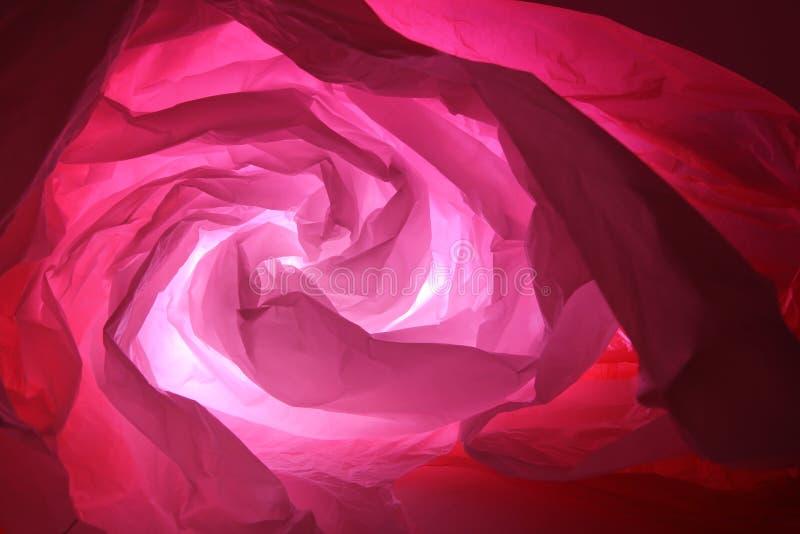 Abstrakt bakgrund av insidorna av en röd plastpåse royaltyfria bilder
