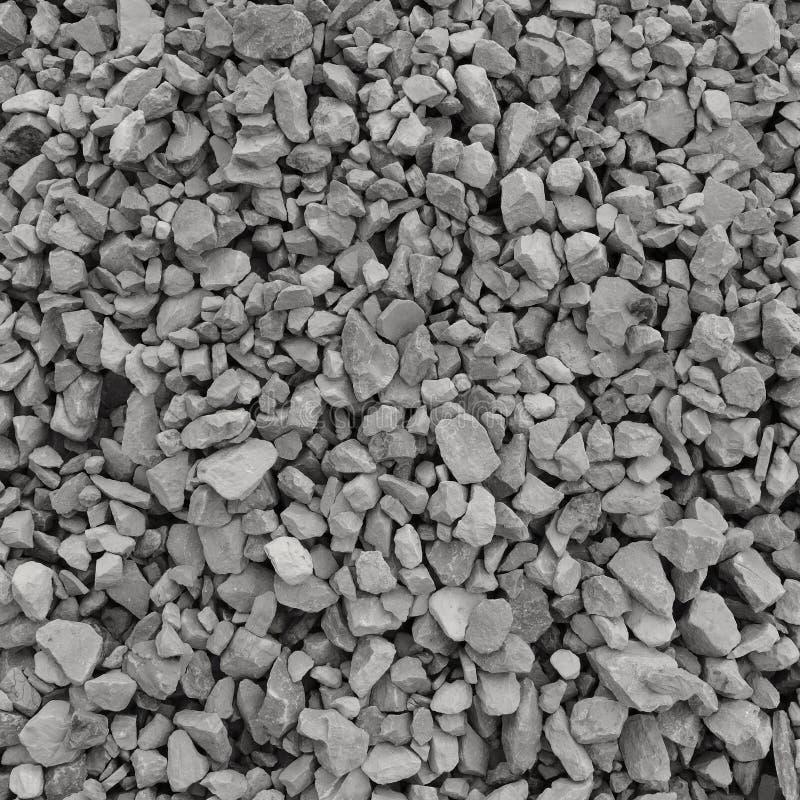 Abstrakt bakgrund för grå färg- och beigagrussten, krossade grå färgstenar och granitstycktextur, stor detaljerad texturerad buse fotografering för bildbyråer