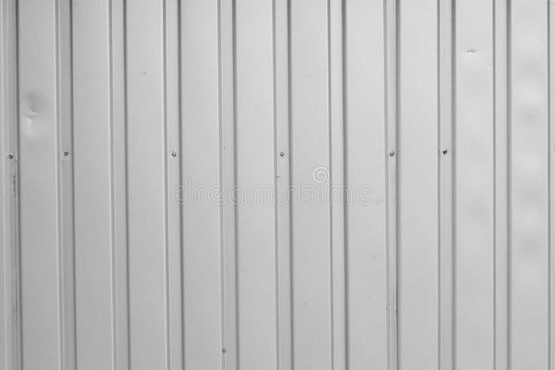 Abstrakt bakgrund korrugerade grå metall för väggen, textur royaltyfria foton