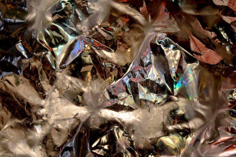 Abstrakt bakgrund med den mjuka modellen i guld royaltyfria bilder