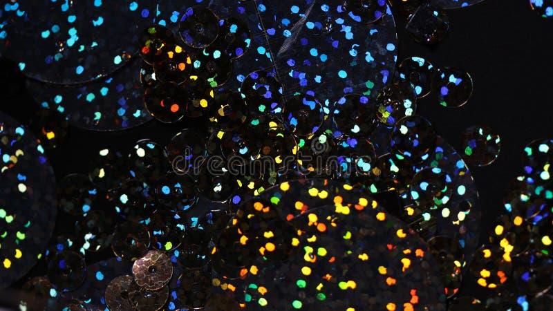 Abstrakt bakgrund med flerfärgad rund paillettenärbild arkivbild