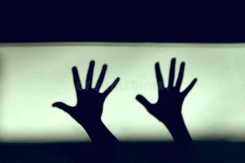 abstrakt bakgrund Svartskuggor av händer på väggen royaltyfria foton