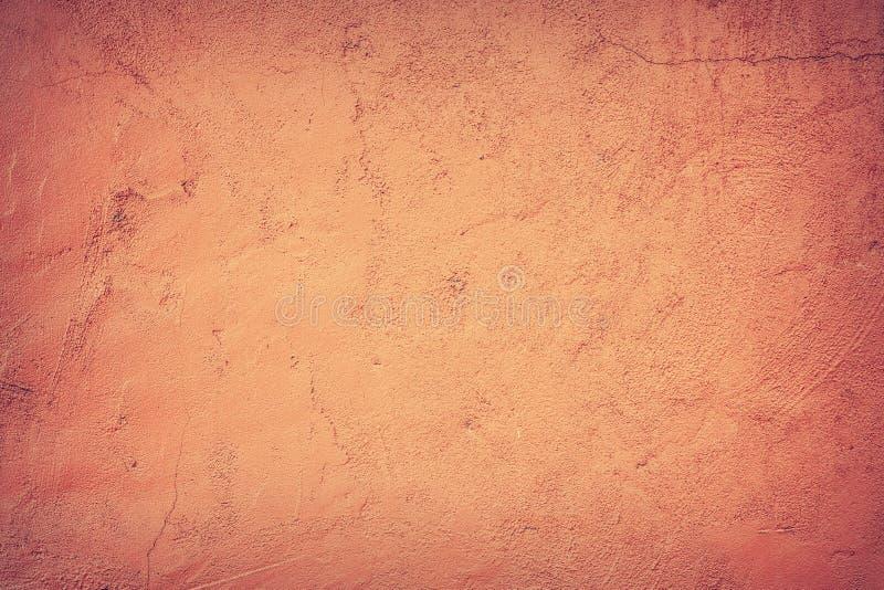 Abstrakt bakgrund, väggen på som den orange murbruken arkivfoto