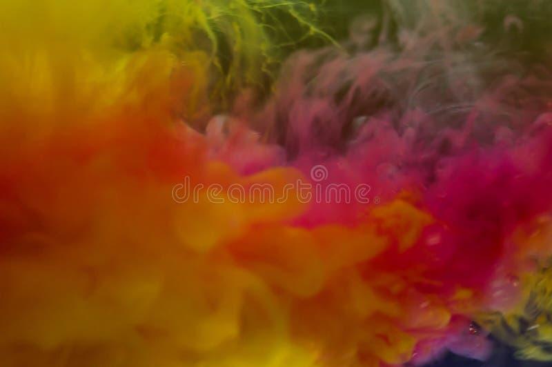 Abstrakt bakgrundsfärgpulver i vatten arkivfoto