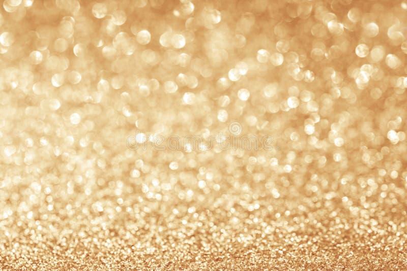 Abstrakt begrepp blänker guld- bakgrund arkivbild