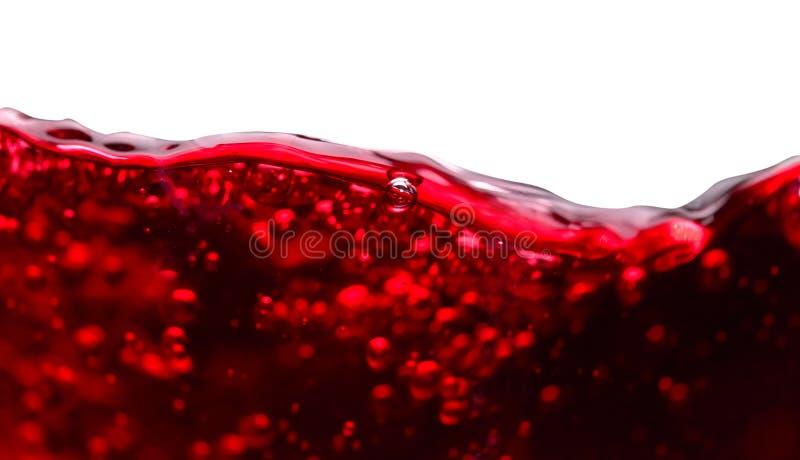 Abstrakt begreppfärgstänk av rött vin på vit bakgrund fotografering för bildbyråer