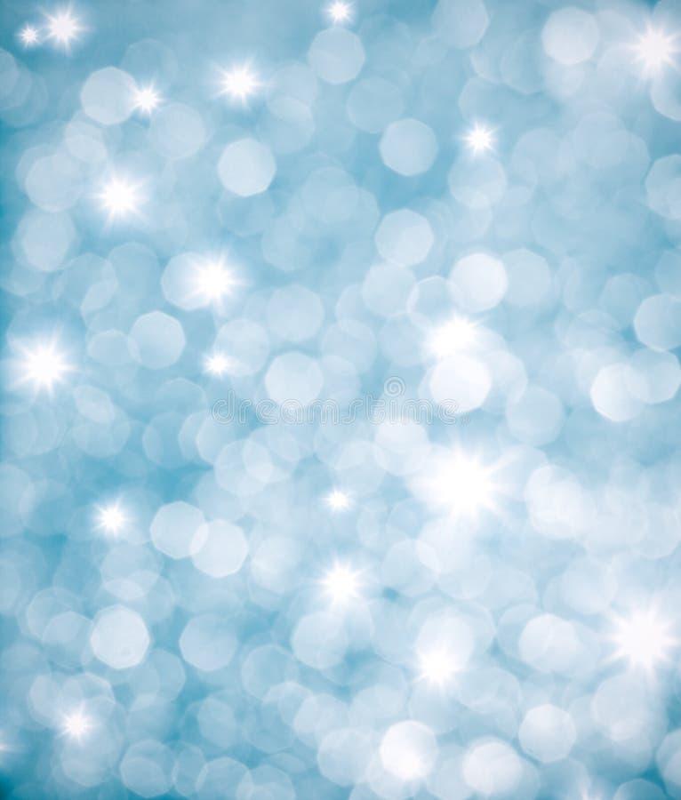 Abstrakt blå bakgrund eller blänka lampor arkivbild