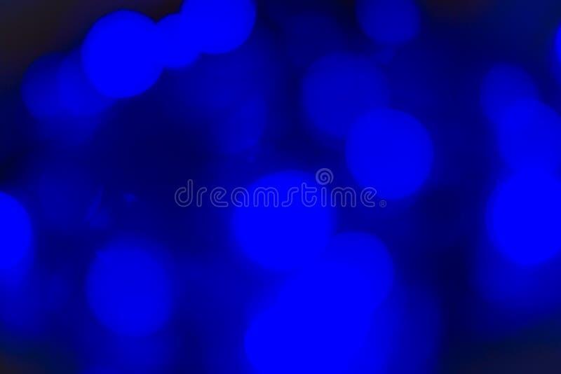 Abstrakt Bokeh textur färgrika blått Defocused bakgrund gjorde suddig ljust ljus royaltyfria bilder