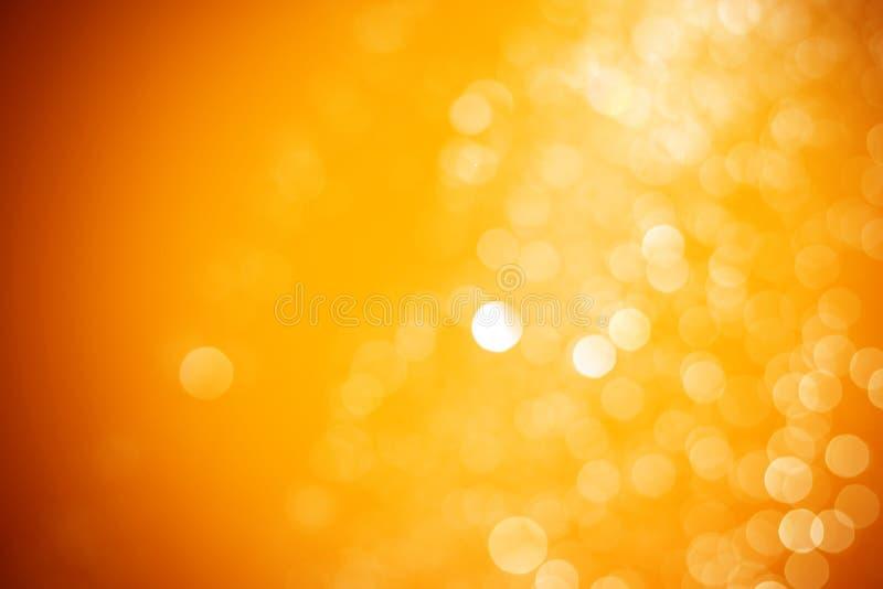 Abstrakt bokehbakgrund för orange och gult ljus Guld för Bokeh bakgrundsfärg royaltyfri foto