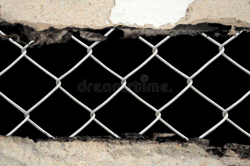 abstrakt chain den porösa staketsammanlänkningen ser väggen arkivfoto