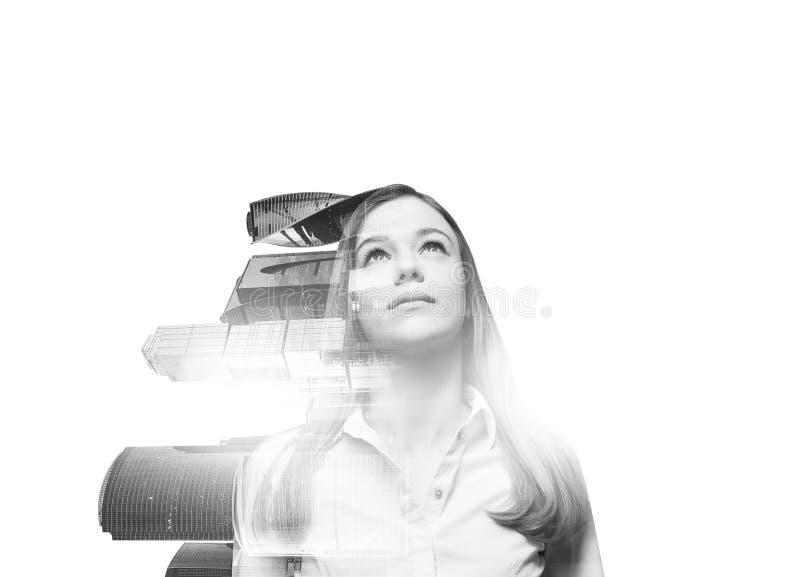 Abstrakt genomskinlig härlig kvinna med sikt för Moskvastadsaffärscentrum på vit bakgrund Ett begrepp av framgång arkivfoton