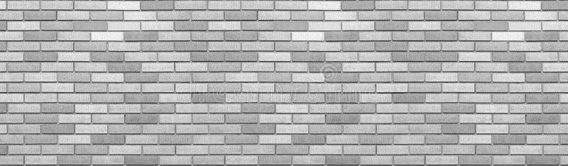 Abstrakt grå bakgrund för textur för tegelstenvägg Horisontalpanoramautsikt av murverktegelstenväggen fotografering för bildbyråer