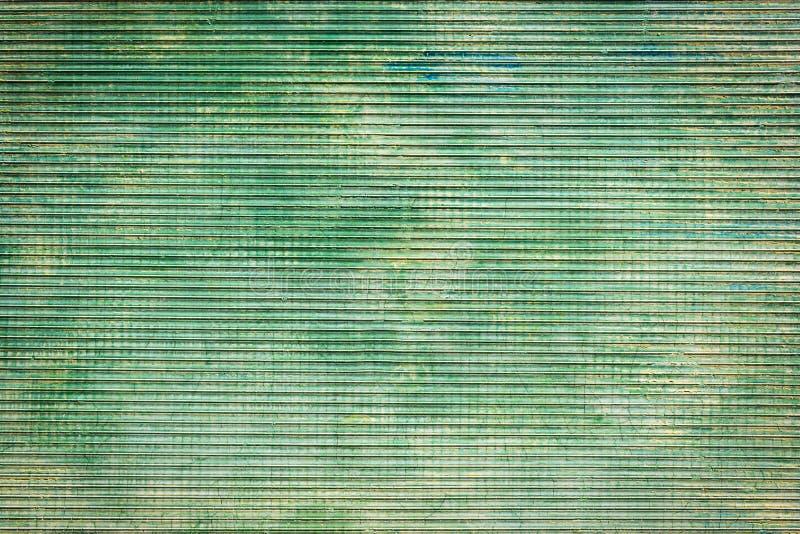Abstrakt grön metalltexturbakgrund royaltyfri bild