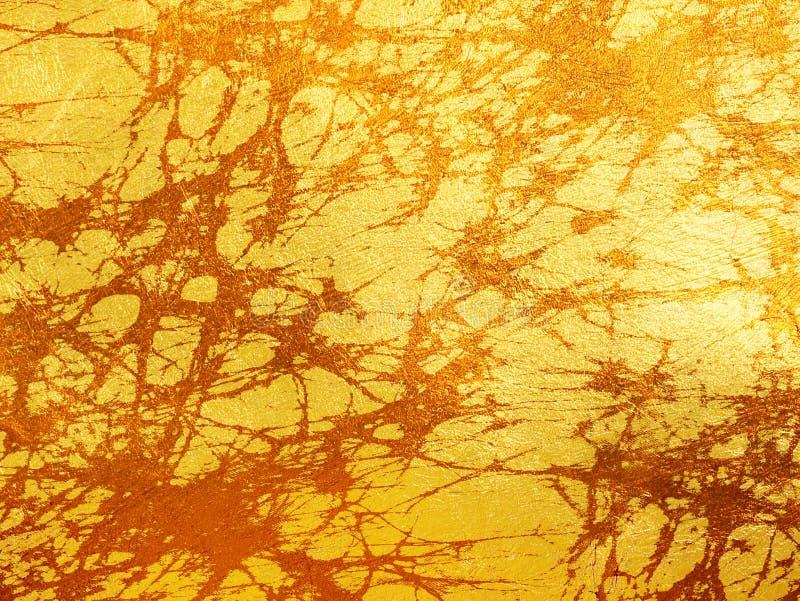 Abstrakt guld- textur - batikmodell arkivfoto