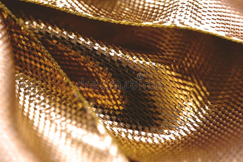 Abstrakt guld- textur, skalastil arkivbild