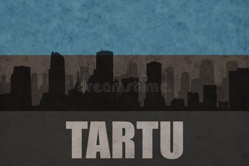 Abstrakt kontur av staden med text Tartu på den estonian flaggan för tappning arkivfoton