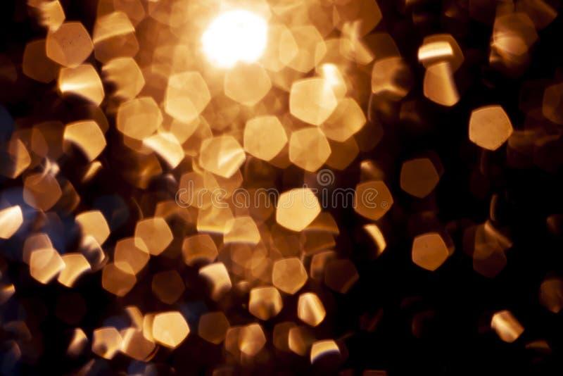 Abstrakt ljus är skimrar guld arkivfoto