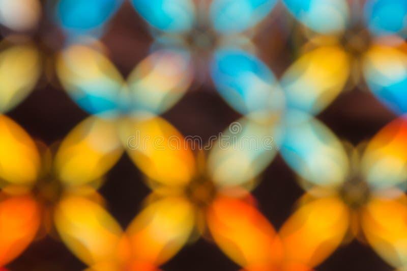 Abstrakt mångfärgad strålningsbakgrund Bakgrund i form av suddiga romber arkivbild