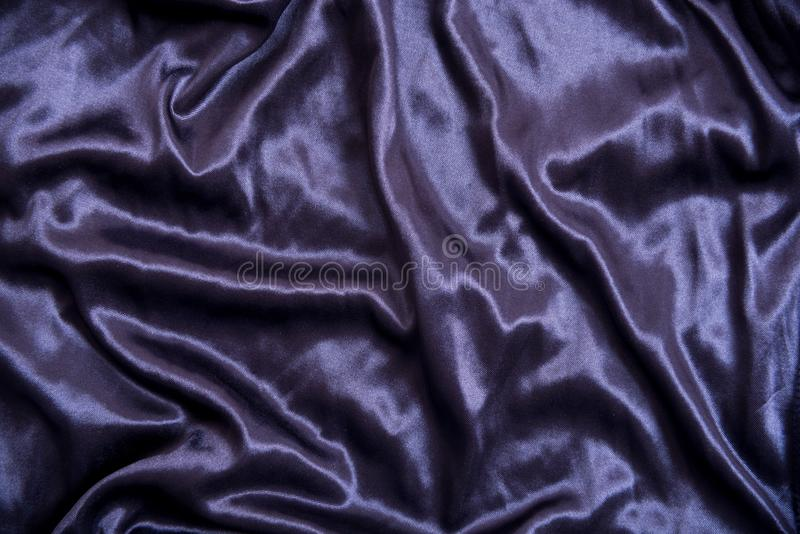 Abstrakt mörker - blå tygtextur för bakgrund arkivfoto