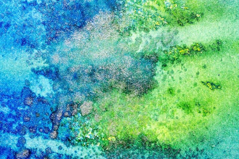 Abstrakt metallisk bakgrund för blått och för gräsplan royaltyfria foton