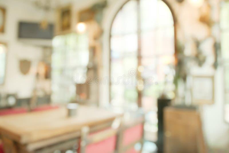 Abstrakt oskarp ljus restaurang arkivbild