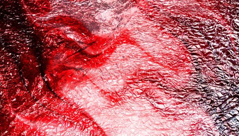 Abstrakt röd skuggad metallisk texturerad bakgrund med belysningeffekter wallpaper arkivfoto