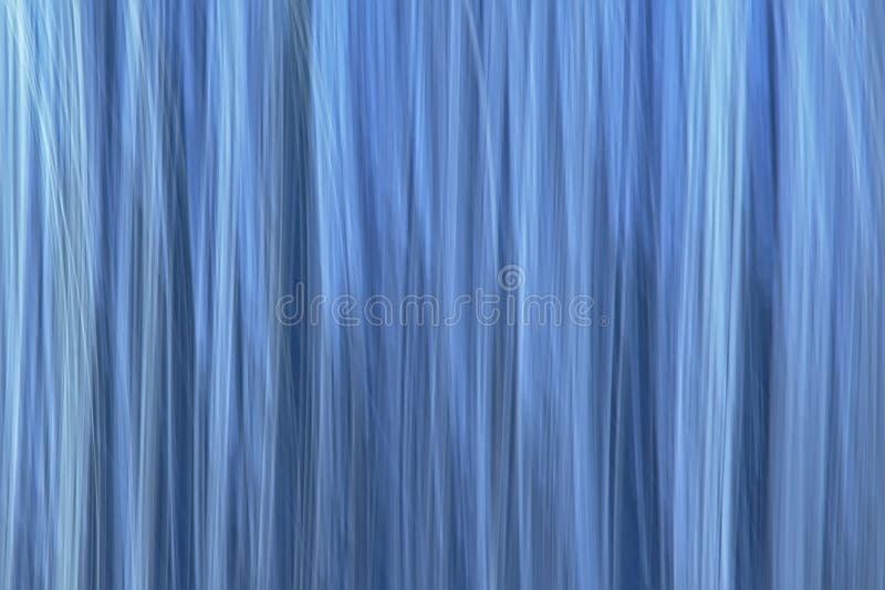 Abstrakt suddig blå bakgrund för rörelse royaltyfria foton
