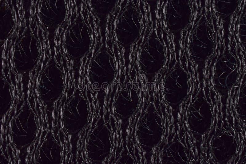 Abstrakt svart stucken tygbakgrund royaltyfri foto