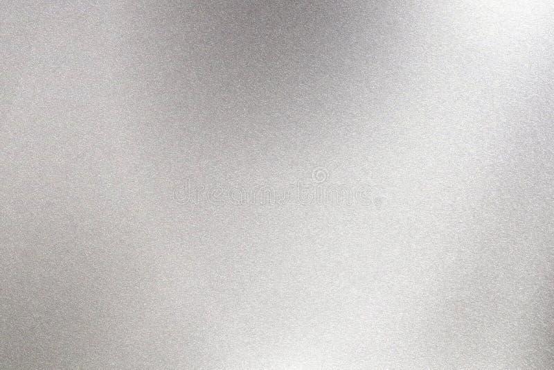 Abstrakt texturbakgrund, ljust skina på grovt rostfritt stål arkivbilder
