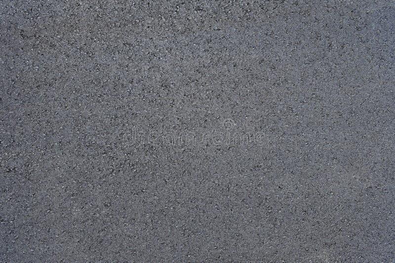 Abstrakt texturerad bakgrund för bitumen asfalt fotografering för bildbyråer