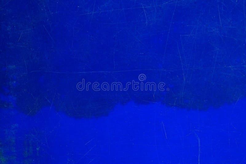 Abstrakt wietrzał naturalną porysowaną starą błękitną plastikową teksturę su zdjęcie stock