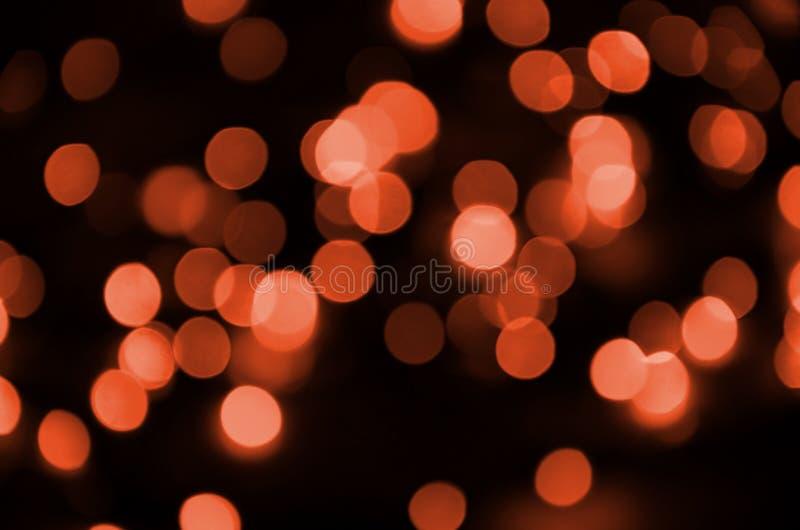 Abstrakt zamazywał czerwony błyskotliwy połysk żarówek świateł tło Plama Bożenarodzeniowy tapetowy dekoraci pojęcie obraz royalty free