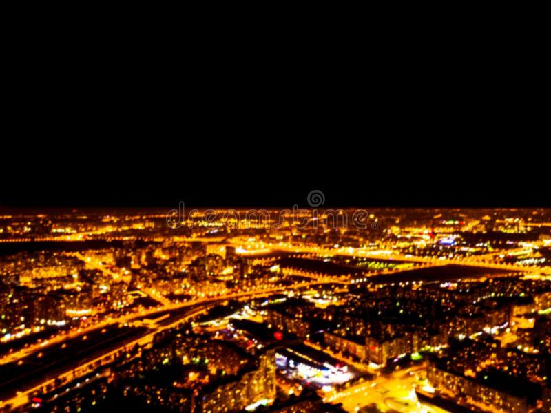Abstrakt Zamazywał tło nocy Powietrznego widok duży miasto Pejzaż miejski panoramy bokeh przy nocą Rozmyty widok z lotu ptaka dra fotografia stock