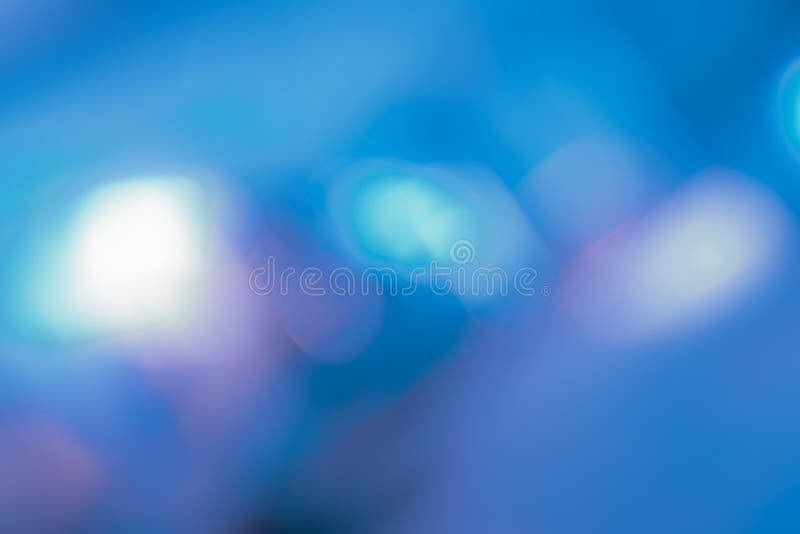 Abstrakta blått blänker färgbokeh, mjuk suddighet för fokus abstrakt bakgrund arkivbild