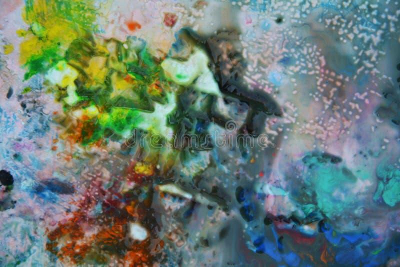 Abstrakta blandade färger och toner för lilagulingblått Abstrakta unika blöter målarfärgbakgrund Målningfläckar arkivfoton