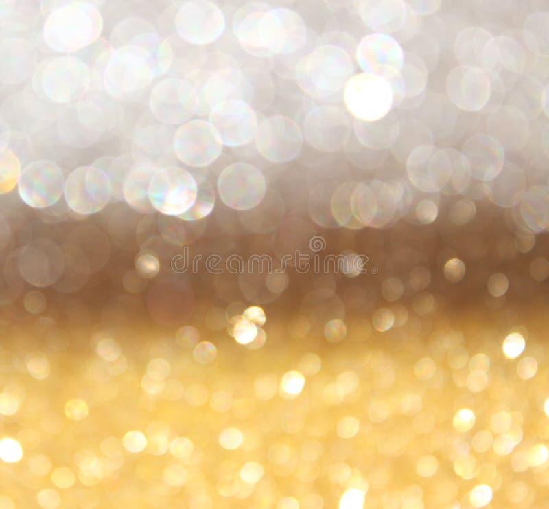 Abstrakta bokehljus för vit och för guld. defocused bakgrund royaltyfri bild