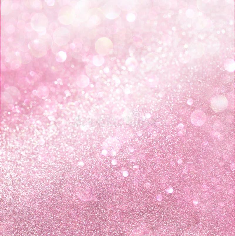 Abstrakta bokehljus för vit och för rosa färger royaltyfri fotografi