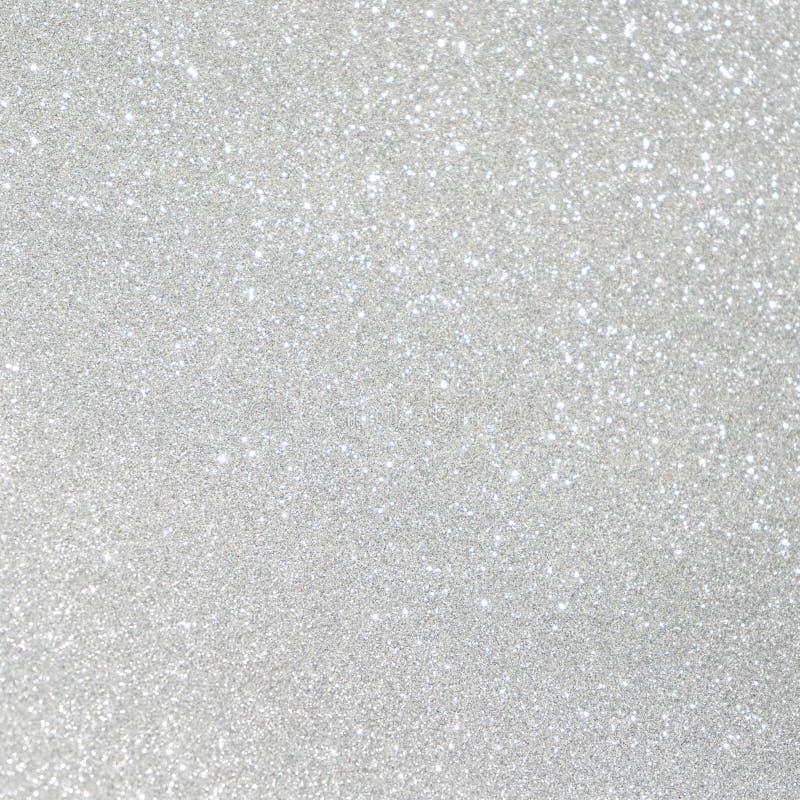 Abstrakta bokehljus för vit och för silver defocused bakgrundsbli arkivbild