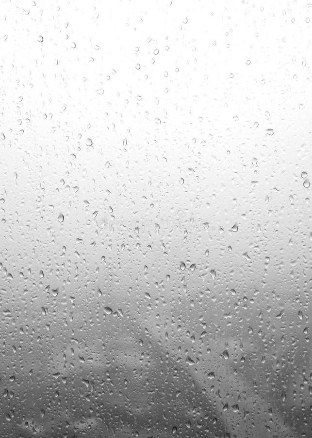 Abstrakta deszczu krople na outside nadokiennym szkle zdjęcia stock