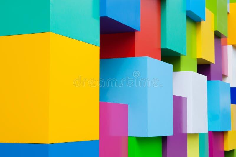 Abstrakta färgrika arkitektoniska objekt Guling som är röd, gör grön, slösar, rosa färger, vit färgade kvarter Pantone färgar beg royaltyfria bilder