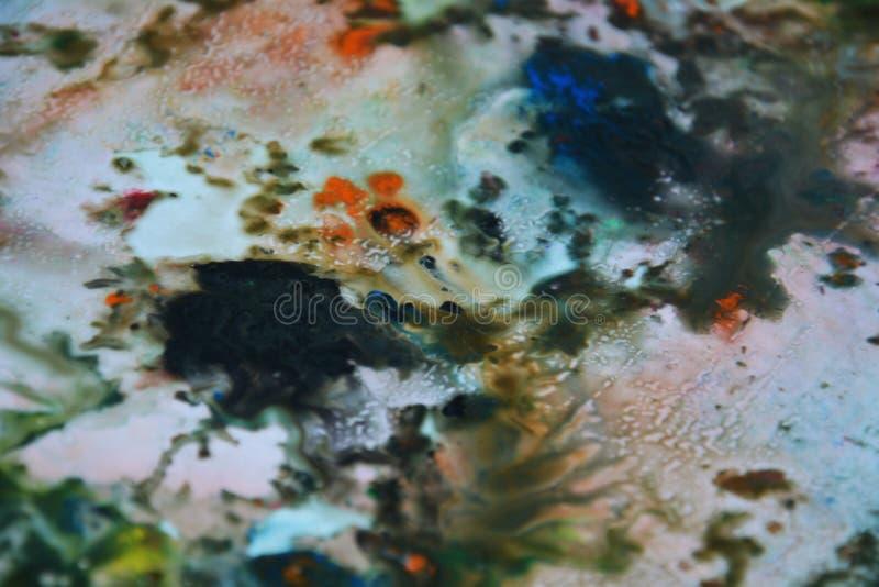 Abstrakta för blandningmålarfärg för blå gräsplan orange färger och toner Abstrakta unika blöter målarfärgbakgrund Målningfläckar royaltyfria bilder
