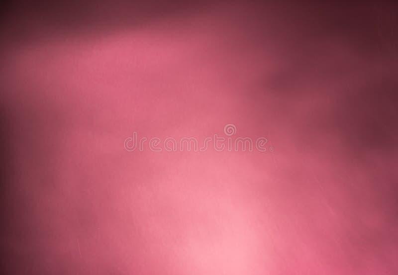Abstrakta rosa färger röker ljus lutning på en mörk bakgrund arkivfoto