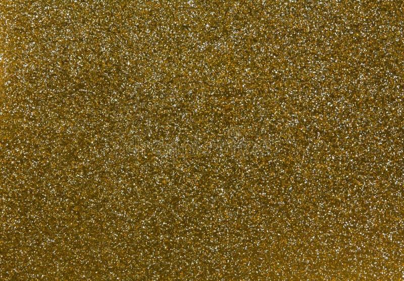 Abstrakte goldene Funkelnbeschaffenheit lizenzfreie stockbilder