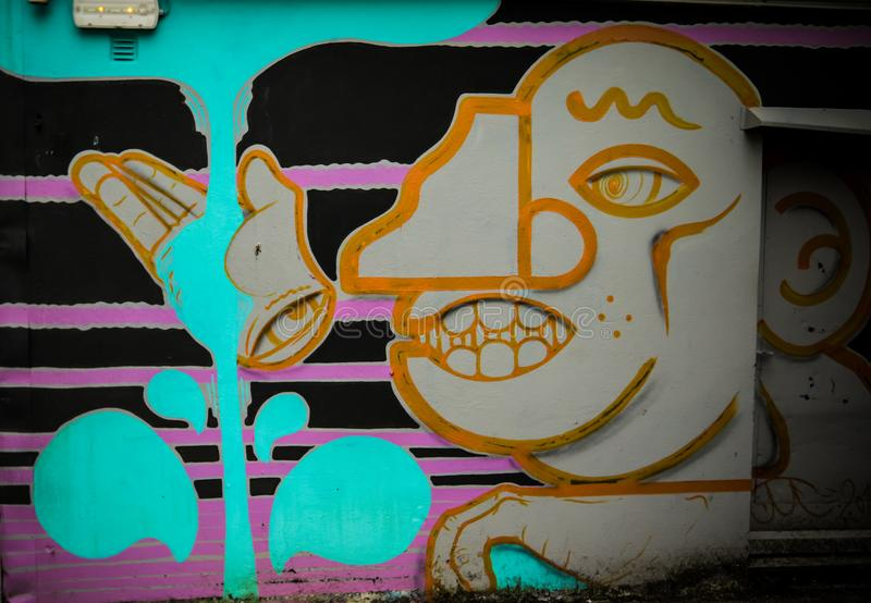 Abstrakte grinsende Gesicht Graffiti lizenzfreies stockfoto