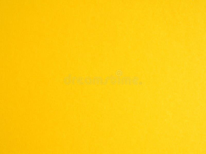 abstrakte Hintergrundtapete mit goldener Beschaffenheit des gelben Papiers stockbild