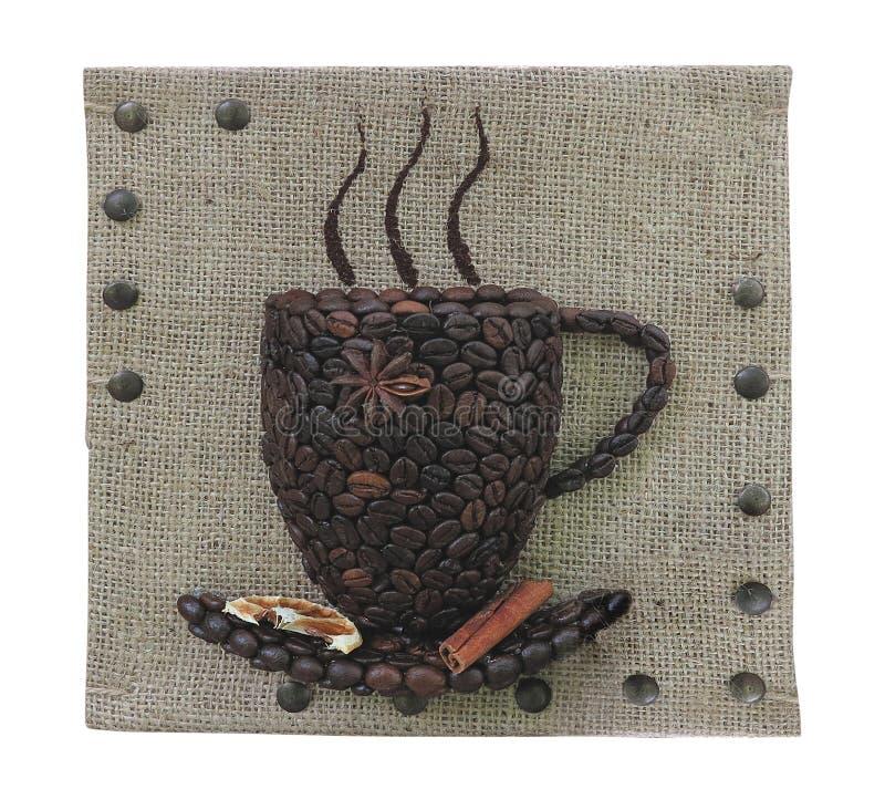 Abstrakte Kaffeebohnen überfallen Konzept über Leinwandsegeltuchhintergrund stockbilder